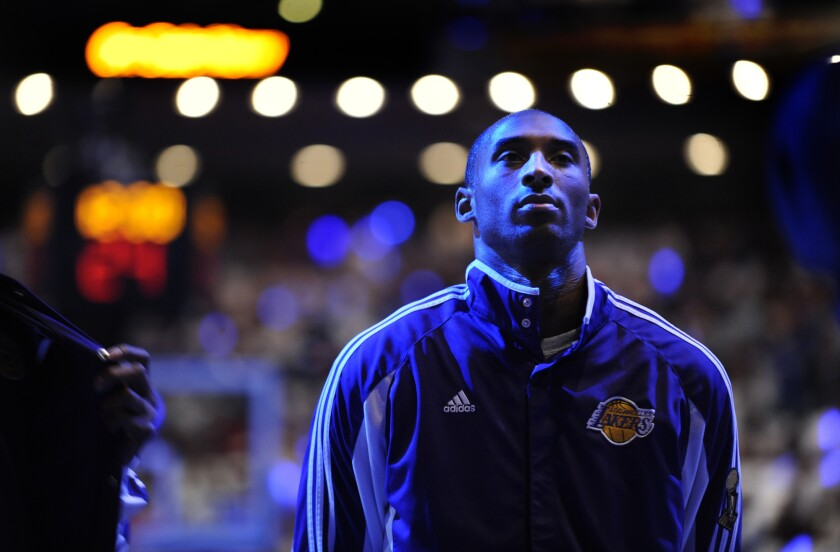 Kobe Bryant listens to the national anthem before Game 3 of the 2009 NBA Finals in Orlando, Fla.