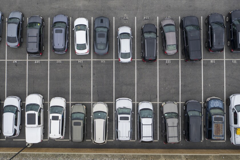 An aerial view shows cars parked for a drive-in Easter church service at New Harvest church