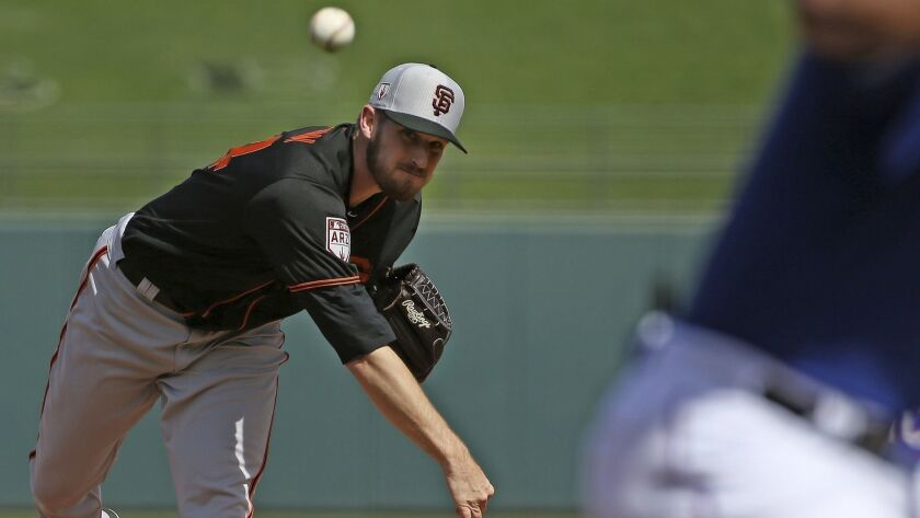 San Francisco Giants starting pitcher Chris Stratton throws a pitch against the Texas Rangers during