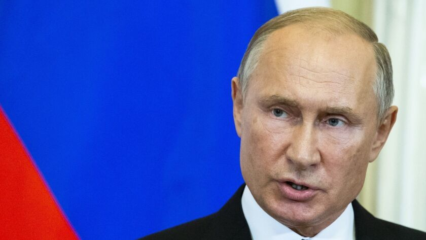 Russian President Vladimir Putin speaks to the media during a joint news conference with Hungarian P
