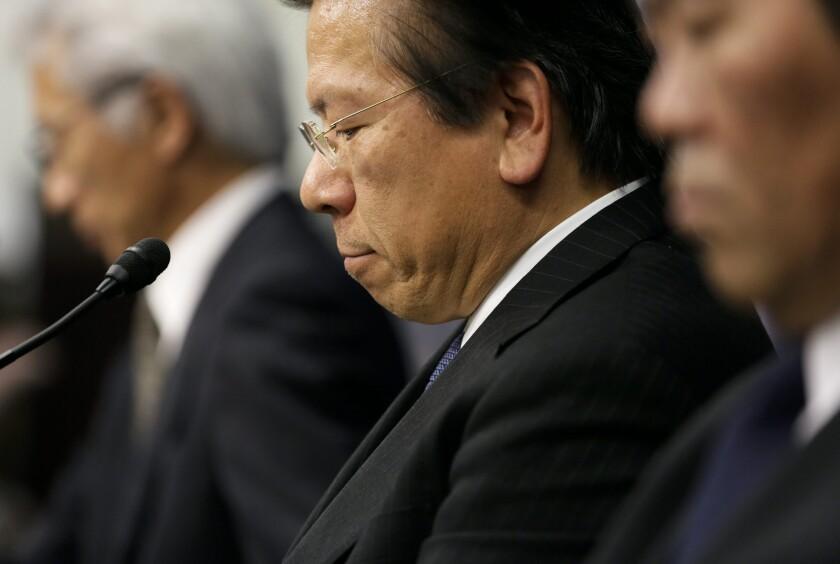 Tetsuro Aikawa, president of Mitsubishi Motors, listens during a Tuesday news conference in Tokyo.