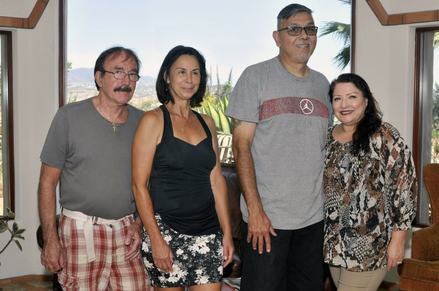 Hosts Val and Treasurer Sandy Popescu, Coastline Out2Reach Ministry founders Bobby and Alice Amaro