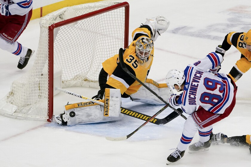 Pittsburgh Penguins goaltender Tristan Jarry (35) stops a shot by New York Rangers' Pavel Buchnevich (89) during the third period of an NHL hockey game Tuesday, March 9, 2021, in Pittsburgh. The Penguins won 4-2. (AP Photo/Keith Srakocic)