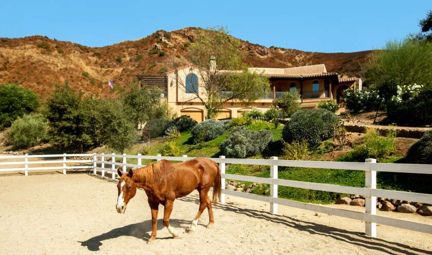 The Agoura Hills compound includes a main house, guesthouse, studio apartment, swimming pool and multiple riding arenas.