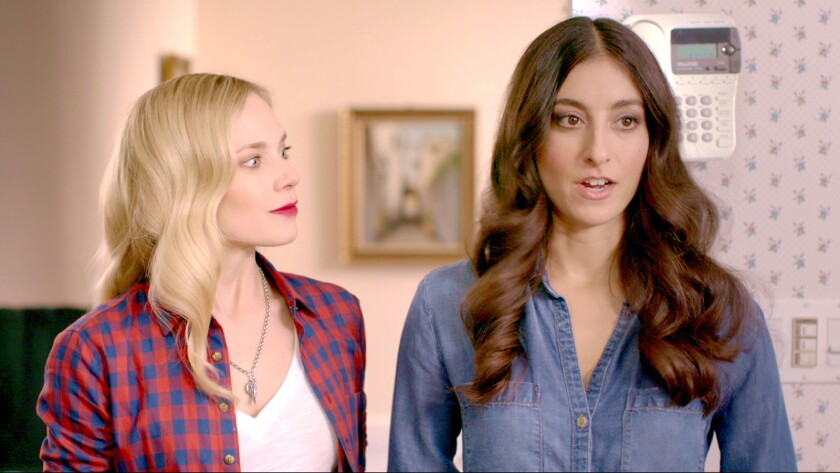 """(L-R) - Caitlin Mehner and Jenna Laurenzo in a scene from the movie """"Lez Bomb."""" Credit: Gravitas Ven"""