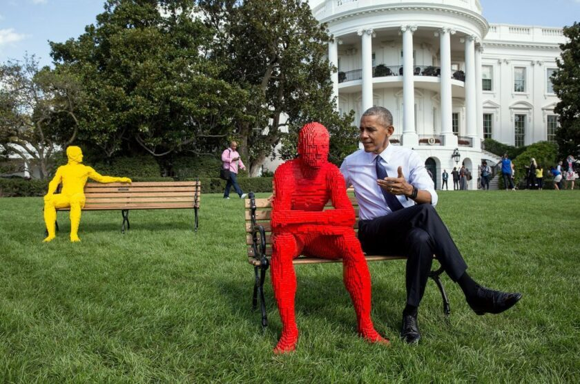 President Obama sits with a Lego statue created by artist Nathan Sawaya for the festival South by South Lawn at the White House.