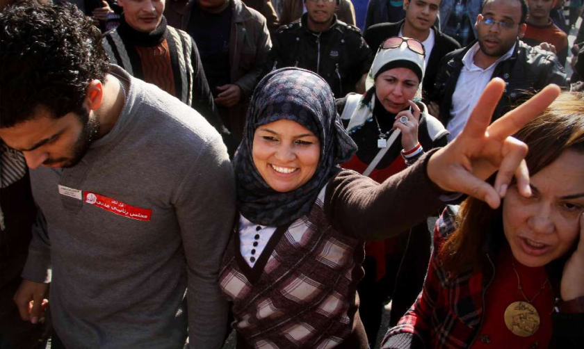 "Samira Ibrahim flashed the victory sign in Cairo, Egypt, after a court there ordered the country's military rulers to stop performing ""virginity tests"" in December, 2011. Ibrahim had filed a lawsuit after being subjected to a forced ""test."""