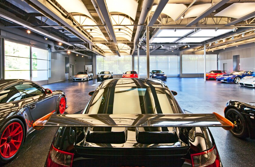 In Malibu, a home attached to a high-tech car museum has traded hands for $7.325 million.