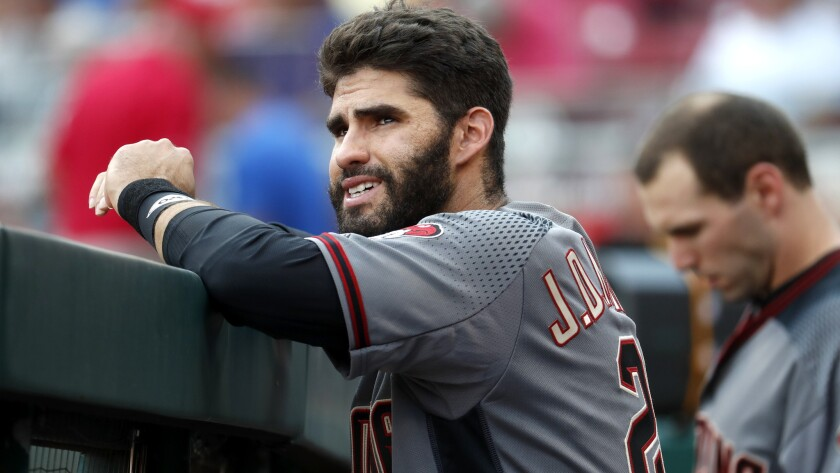 Diamondbacks right fielder J.D. Martinez watches his teammates bat during a game against the Reds on Aug. 12, 2017. Martinez is one of a handful of free agents still available.