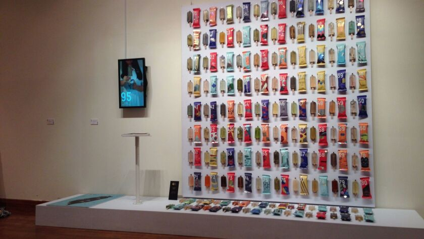 Exhibition showing replicas of popsicles that three university students created from tainted water a