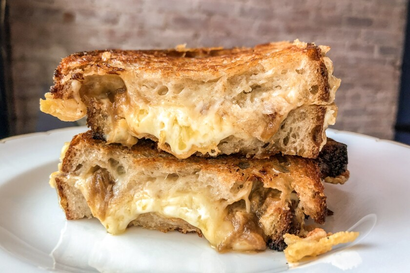 The grilled cheese at Pasjoli in Santa Monica: Gruyere cheese, layers of mornay sauce, caramelized onions sandwiched between country bread.