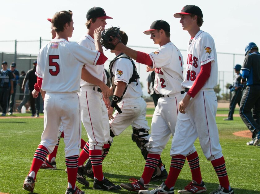 Senior Brett Volger (2) accepts congratulations from teammates after closing the Vikings' 5-3 first round playoff win over visiting Eastlake. It was the LJHS all-leaguer's third save of the 2014 campaign. He had a miniscule 0.78 ERA in seven appearances. Photos by Ed Piper