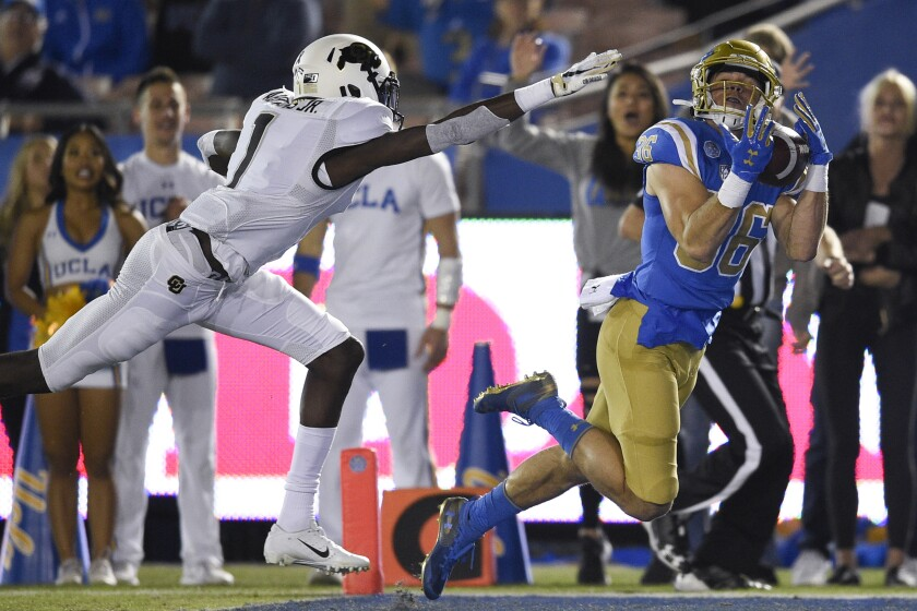 UCLA wide receiver Ethan Fernea catches a pass for a touchdown in front of Colorado cornerback Delrick Abrams Jr.