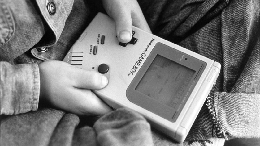 London - A boy playing on one of the first Nintendo Game Boy computers