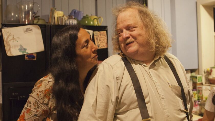 Jonathan Gold with Laurie Ochoa in the kitchen of their Pasadena home.