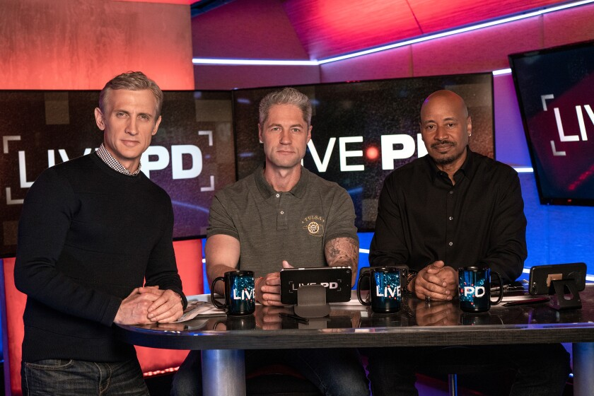 """A&E's """"Live PD"""" host Dan Abrams in the studio with analysts Sean """"Sticks"""" Larkin and Tom Morris Jr."""