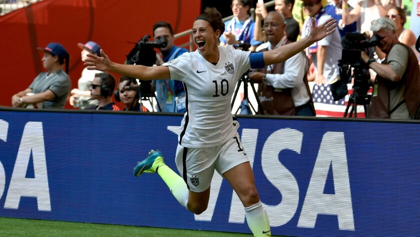 Carli Lloyd celebrates her second goal in the first half against Japan in the 2015 FIFA Women's World Cup final.
