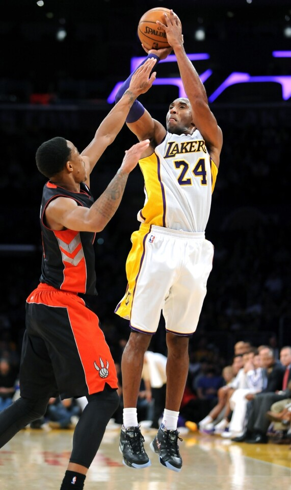 Lakers guard Kobe Bryant elevates for a three-point shot over Raptors guard DeMar DeRozan in the fourth quarter. Bryant would miss all three long-range shots he took, finishing two-of-nine from the field for nine points.