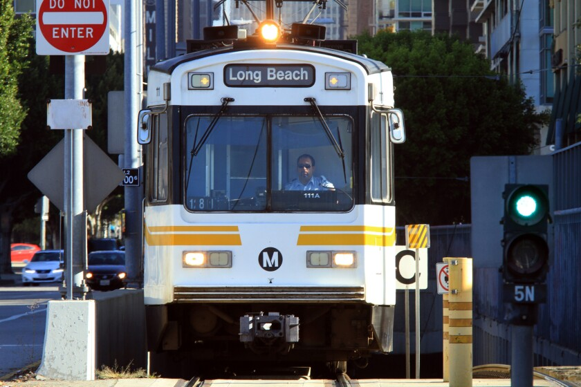 A Metro train with a Long Beach destination sign