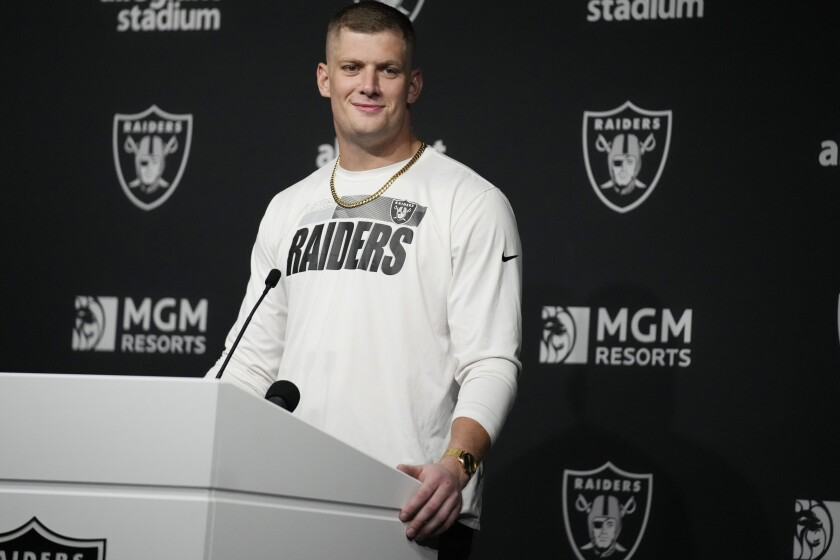Carl Nassib at a lectern for a news conference