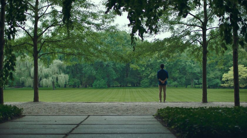 """Jin (John Cho) takes in the lush view of the Miller House Gardens in """"Columbus."""""""