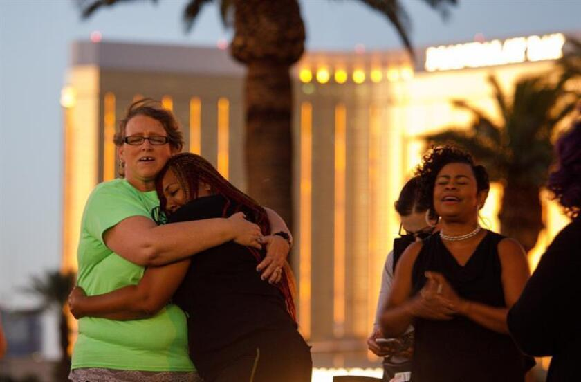 Parishioners from The Gathering church pray near the Mandalay Bay hotel in memory of the victims of the mass shooting in Las Vegas, Nevada, USA, 03 October 2017 (reissued 30 September 2018). EFE/EPA/FILE