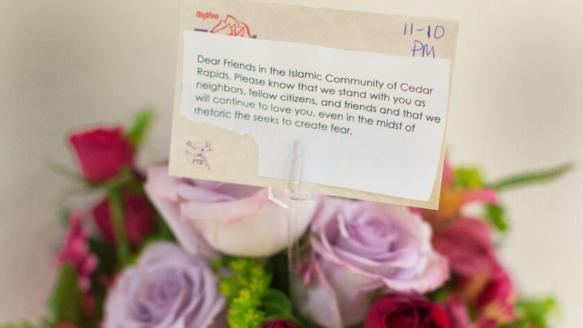A bouquet of flowers and an encouraging note given to the Islamic Center of Cedar Rapids, in Cedar R