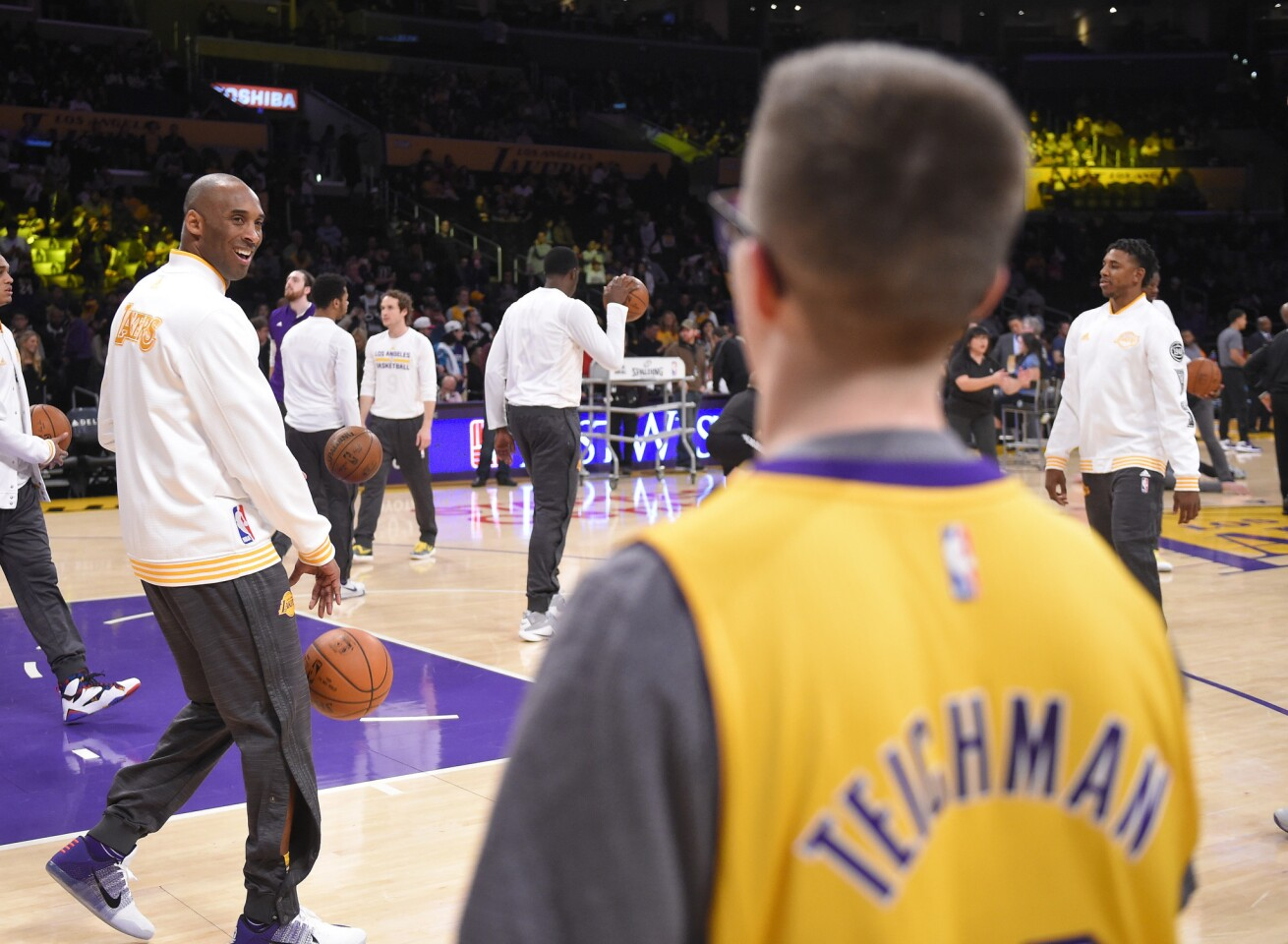 Los Angeles Lakers forward Kobe Bryant, left, talks with Make-A-Wish recipient, Yitzi Tiechman prior to an NBA basketball game against the Charlotte Hornets, Sunday, Jan. 31, 2016, in Los Angeles. The Lakers signed Teichman to a one day contract with the Lakers prior to the game. (AP Photo/Mark J. Terrill)