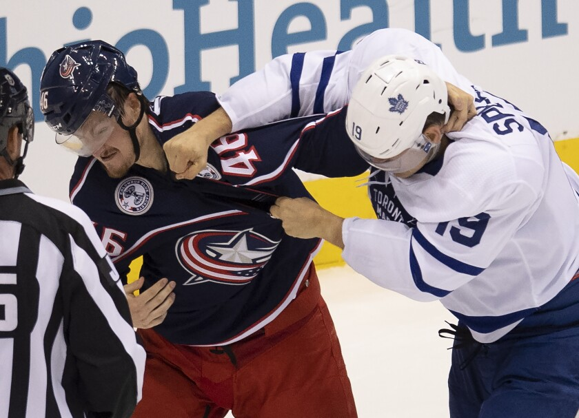Toronto Maple Leafs center Jason Spezza (19) lands a punch on Columbus Blue Jackets defenseman Dean Kukan (46) during the second period of an NHL hockey playoff game Friday, Aug. 7, 2020, in Toronto. (Frank Gunn/The Canadian Press via AP)