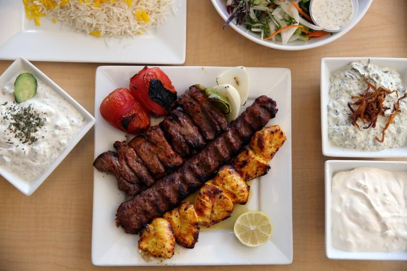 Taste of Tehran kebab plate with rice, house salad and yogurt