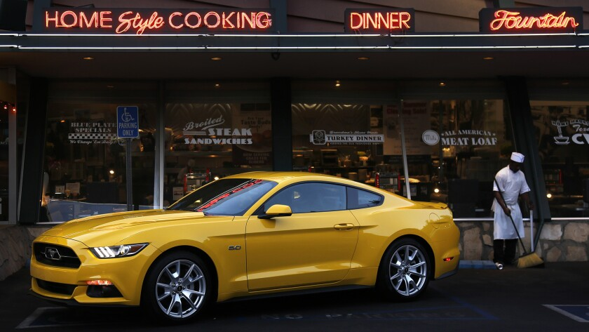 A new 2015 Ford Mustang in the parking lot of Mel's Drive-in in West Hollywood on Sept. 17. Ford brought a fleet of 50 early-production Mustangs to Southern California for 250 car critics to put the car through its paces in the local mountains and on the Pacific Coast Highway.