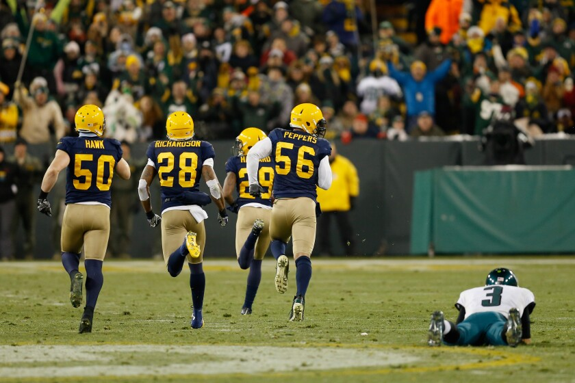 "As a member of the Packers, Casey Hayward (29) is on his way to a touchdown and a ""Lambeau Leap"" after a fumble recovery at Lambeau Field in Green Bay."