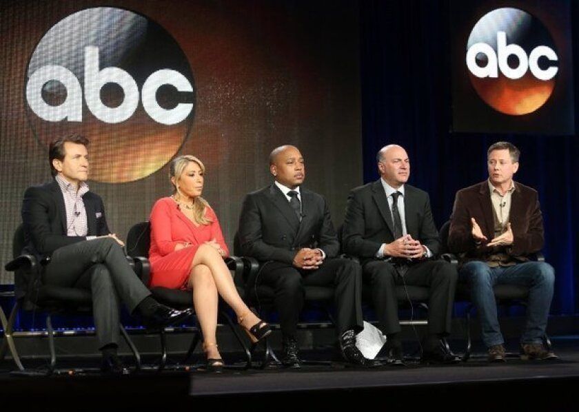 "Hosts Robert Herjavec, Lori Greiner, Daymond John, Kevin O'Leary and executive producer Clay Newbill of ""Shark Tank"" speak onstage during the ABC portion of the 2013 Winter TCA Tour at Langham Hotel in Pasadena."