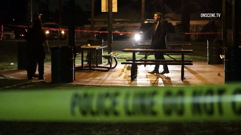 Investigators examine Veterans Park in Fontana, were two men were shot, one fatally, during a confrontation Tuesday night.