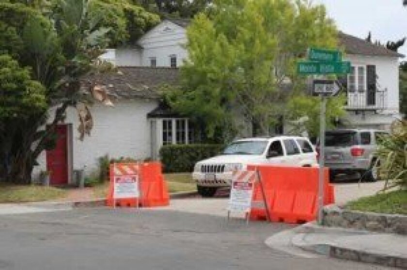 Just prior to the Memorial Day weekend, orange barricades were placed at the entrance to the section of Dunemere Drive where Romney's house is located.