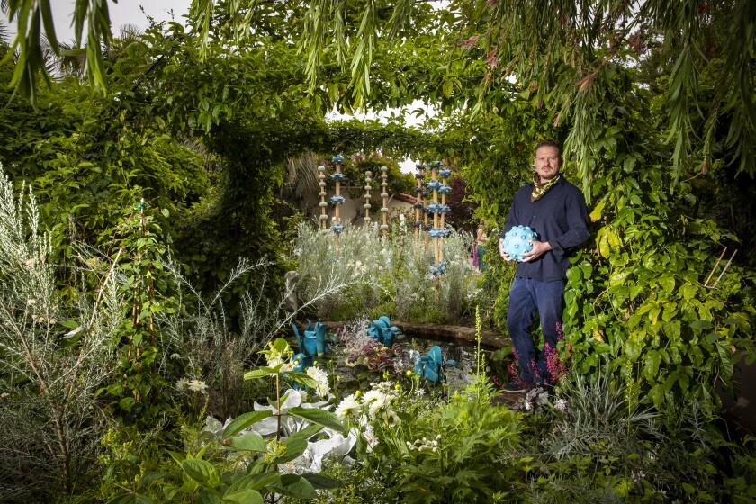 """Dustin Gimbel at his """"Sculptura Botanica"""" show"""