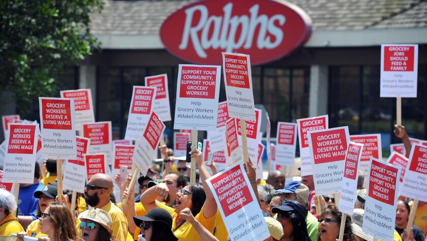 Grocery workers and supporters rally in front of grocery stores on Aug. 2 to demand a new contract.