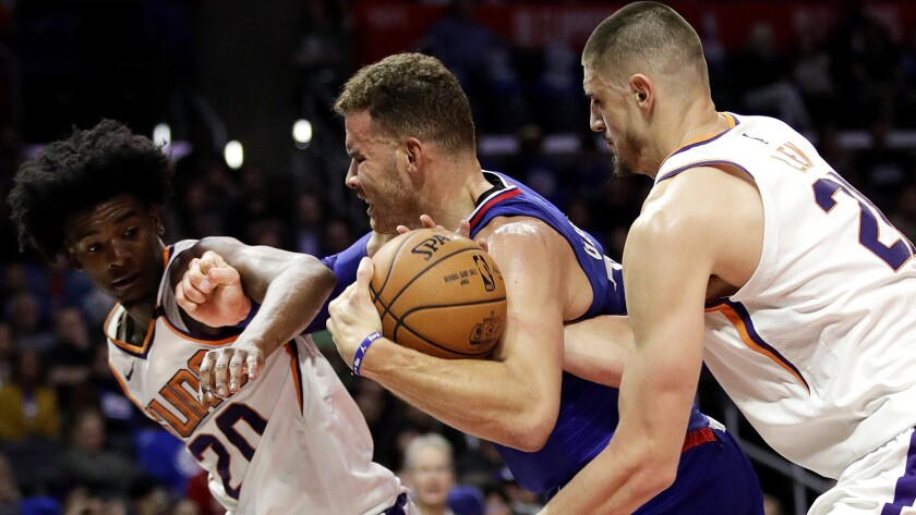 Clippers forward Blake Griffin tries to power his way past Phoenix's Josh Jackson, left, and Alex Len during the second half Saturday.
