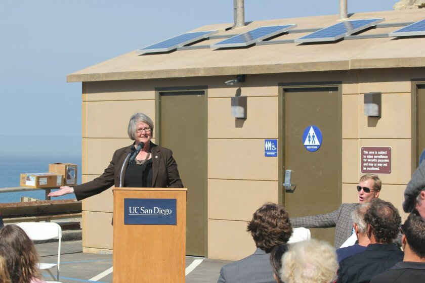 City Council President Pro Tem and District 1 representative Sherri Lightner invites guests to try out the new public restrooms at Black's Beach.
