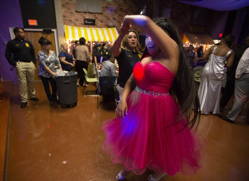 COMMERCE, CA-June 14, 2018 Aurora, 16, salsa dances with Probation Officer Angelica Arellano. (Photo