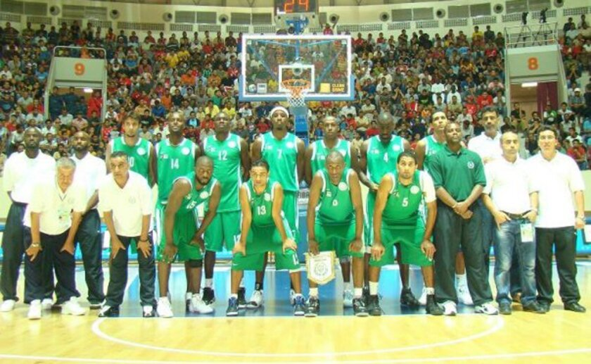 Randy Holcomb (back row, right of backboard) went by the name Raed Farid in Libya.