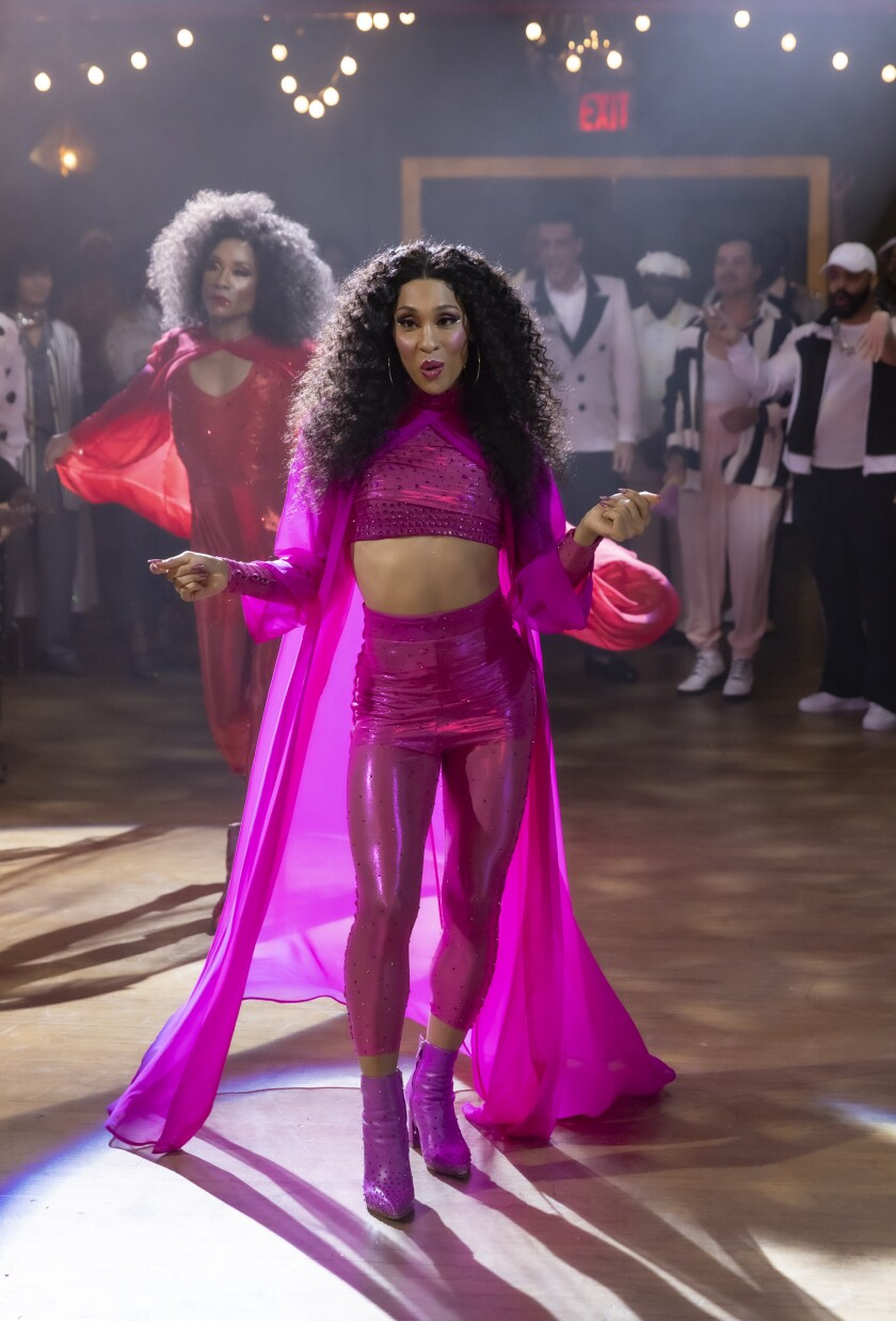 """Mj Rodriguez in a bright pink outfit in a scene from """"Pose."""""""