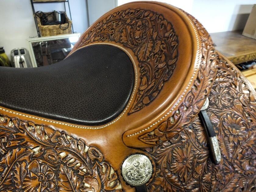 Using his leatherwork and silversmith skills, Pedro Pedrini creates fine saddles in his workshop at Hamley & Co., located along Pendleton's main drag.