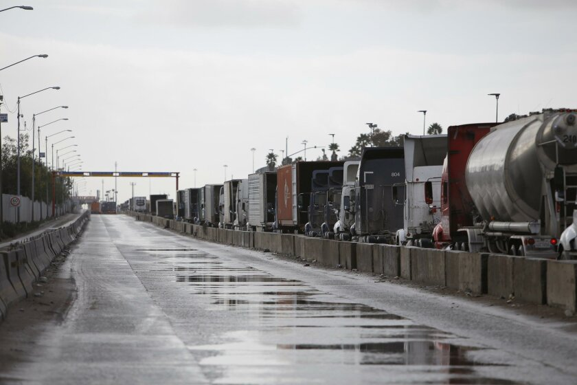 A long line of trucks lines up at the Otay Mesa border crossing. Truck drivers can wait up to 5 hours to cross into the United States.
