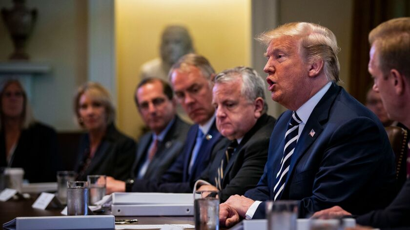 President Trump speaks about the hostages released from North Korea during a Cabinet meeting in Washington on May 9, 2018.