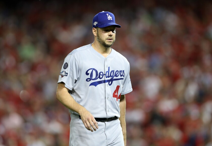 Rich Hill walks off the field after getting pulled during the third inning of a National League division series game against the Nationals on Oct. 7.