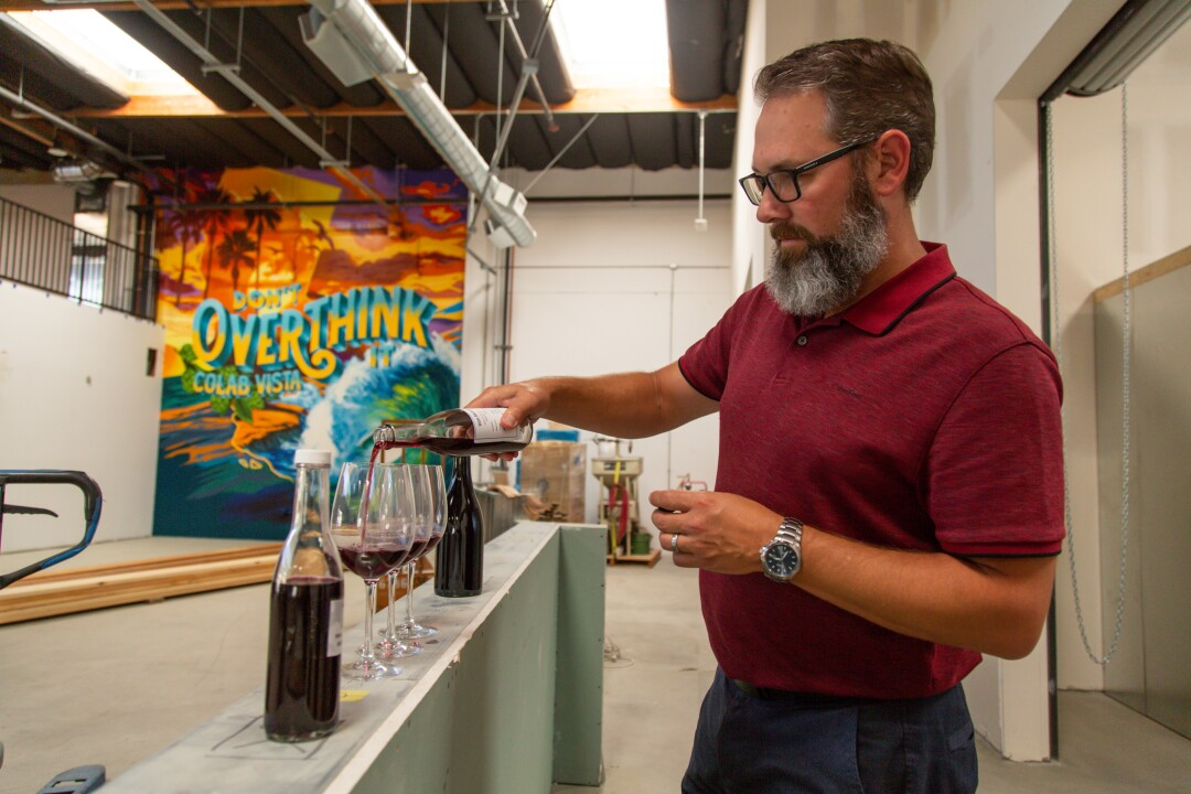Joseph Deutsch pours samples from the cellar he will operate inside Co-Lab Vista.