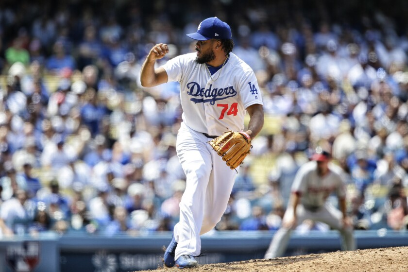 Closer Kenley Jansen reacts after picking up a save against the Nationals during a game this season.