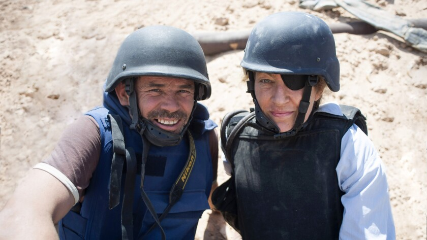 """(L-R) - Paul Conroy with Marie Colvin in a scene from """"Under the Wire."""" Credit: PAULCONROY/Times New"""