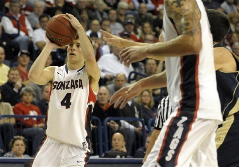 Gonzaga's Kevin Pangos (4) shoots a 3-pointer against Notre Dame, in the second half of an NCAA college basketball game, Wednseday, Nov. 30, 2011, in Spokane, Wash. Gonzaga beat Notre Dame 73-53.(AP Photo/Jed Conklin)
